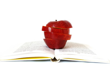 Pieces of apple on the book