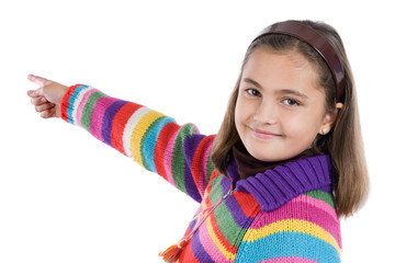 Adorable girl with woollen jacket pointing