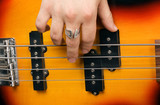 Hand of the artist on guitar strings poster
