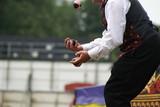hands of a juggler juggling balls. performance poster