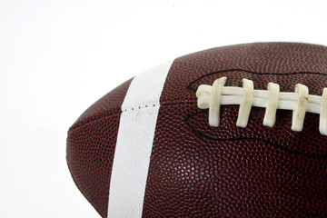Closeup of a football set against a white background