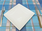 dish with fork and knife at tablecloth poster