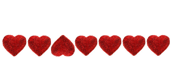 Red beaded hearts isolated against white