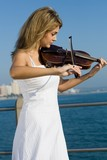 young blond woman play violin