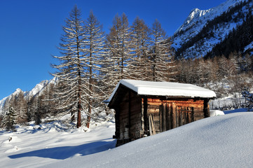 log cabin in the mountains in winter