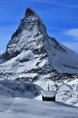 Chapel in snow and Matterhorn