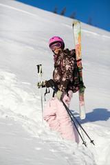 Girl climbing for a freeride