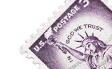 in god we trust postage stamp on white poster