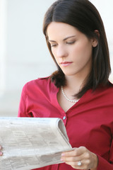 Attractive Business Woman Reading Newspaper