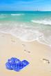 Footprints by flipflops on Beach