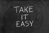 Take it easy phrase on blackboard poster