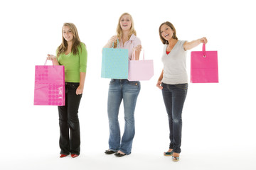 Portrait Of Teenage Girls Holding Shopping Bags