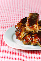 cut up barbecue spare ribs on a plate