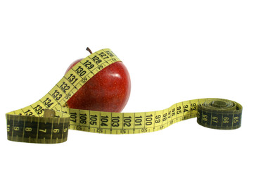 Isolated red apple with measuring tape on white background