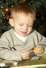 toddler looking at gift tag