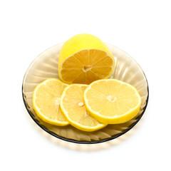 Lemon and lemon slices on plate