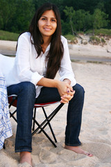 Young Attractive Woman Sitting Down at the Beach