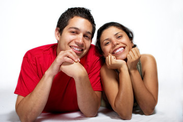 Hispanic young couple sitting together