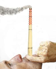 Young caucasian man smoking like a chimney