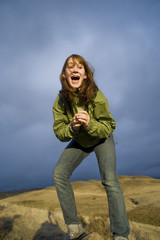 Teen girl shouting with joy