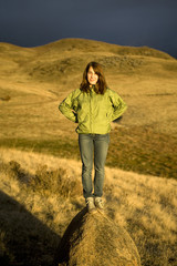 Teen girl standing in beautiful sunset light