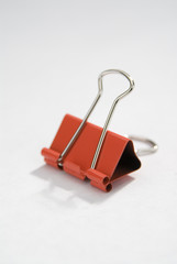 Red binder clip