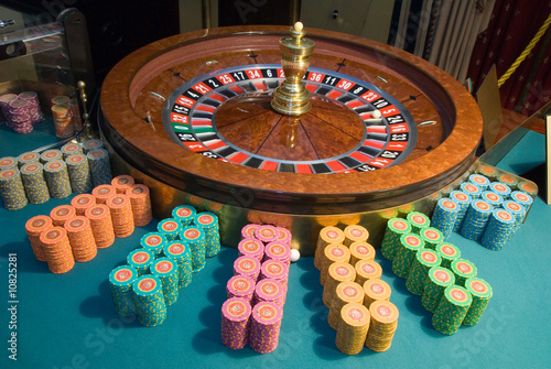 casino roulette wheel and gambling chips