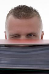 Man stashed  behind folders