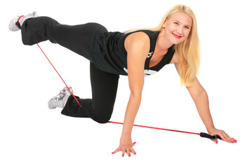 Sport blond makes exercise with rope