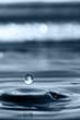 Leinwandbild Motiv Water drop and water rings