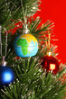 Globe as ornament on christmas tree, christmas concept