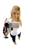 high angle view of smiling model with camcorder