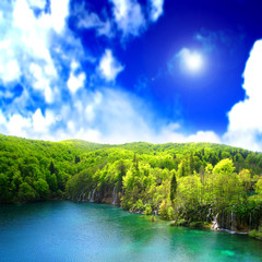 Nature relaxing landscape with lake and waterfalls