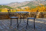 Tables and chairs outside the winery in Napa Valley in Autumn poster