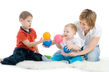 Mother with her sons enjoy with colorful balls