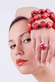 young girl with red coral bracelet