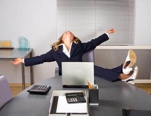 Beautiful woman relaxing in office