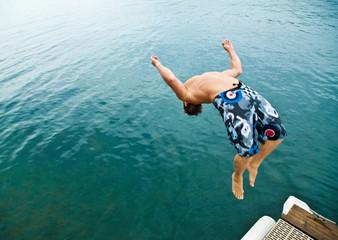 Man doing back-flip into lake