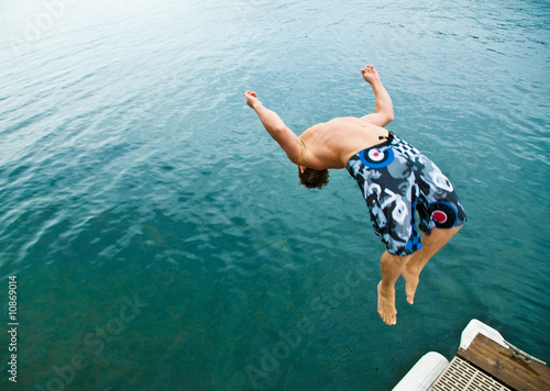 Man doing back-flip into lake