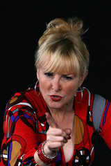 Attractive mature woman in colorful blouse arguing