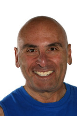 Portrait of bald man in a blue sport shirt