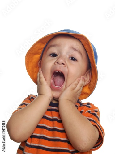 Two-year-old boy with shocked expression