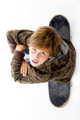 top view of boy sitting on skate