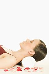 Portrait of a woman relaxing, lying on floor, shut eyes