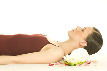 Portrait of a woman relaxing, lying on floor, shut eyes, water lily