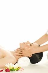 Woman having neck massaged, water lily