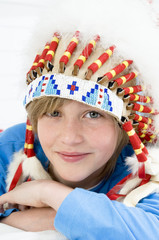 Portrait of a young boy looking at the camera, with indian headdress
