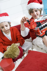 2 boys disguised as Santa Claus playing