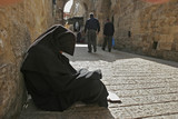 Muslim woman in paranja on Jerusalem street