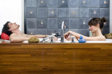 Young couple having a bath
